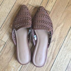 Brown lattice pattern sandals.